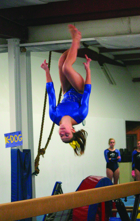 UPSIDE DOWN: Vets' Candis Kowalik competes on the balance beam during Saturday's meet.