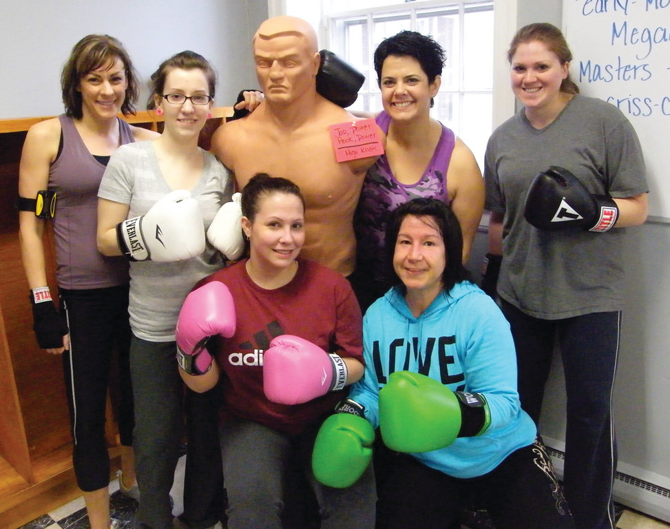 WATCH OUT BOB: The women taking last week's boxing class put up their dukes to take on Bob, the boxing dummy at The Edge Fitness for Women. Pictured are, back row: Instructor Natalina Earls, Chelsea MacDonald, Kristin David and Kara Ilkowitz. Front row: Caroline Gregory and Barbara DeMaio.