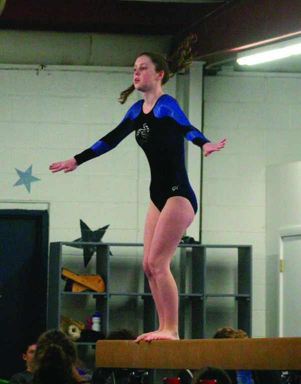 BALANCING ACT: Amber Proulx competes on the balance beam.