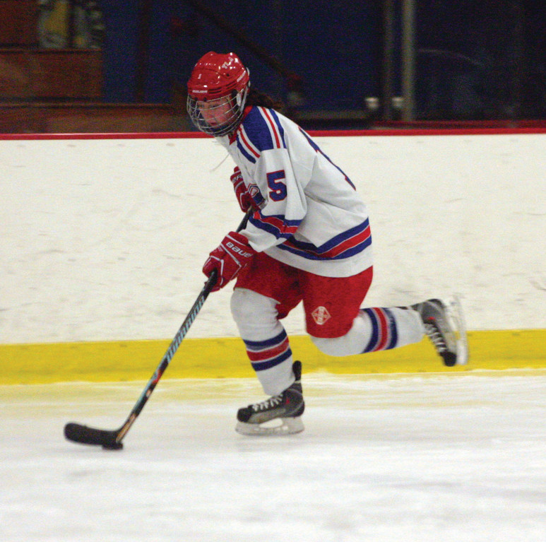 PUSHING THROUGH: Warwick's Abby Ellis carries the puck up the boards on the right side during Saturday's game with Lincoln.