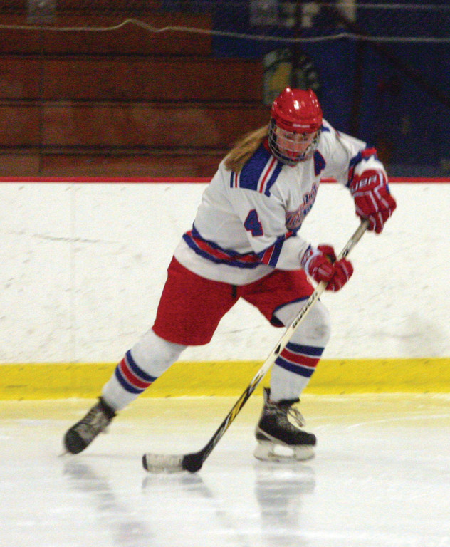 Emma Hindinger traps the puck after receiving a pass.