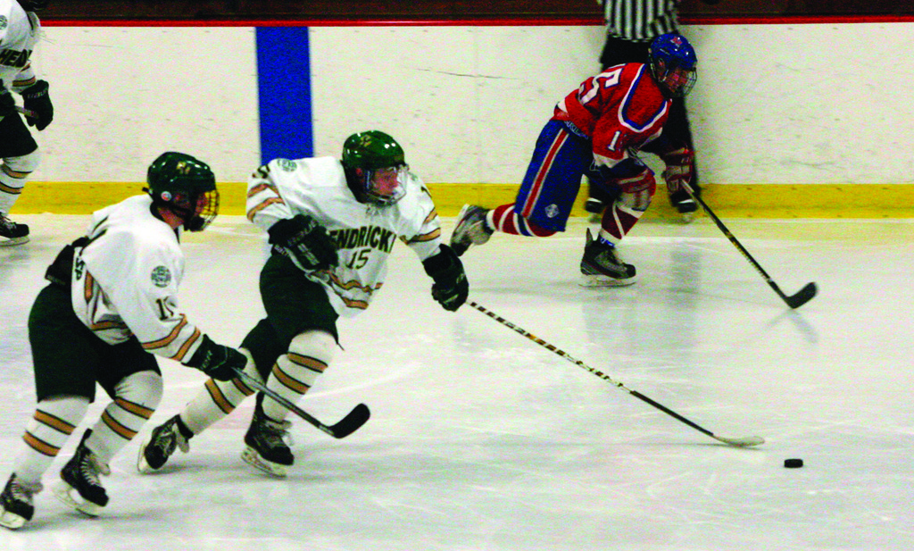 ON THE PUCK: Hendricken's Robbie Buehrer races after a loose puck.