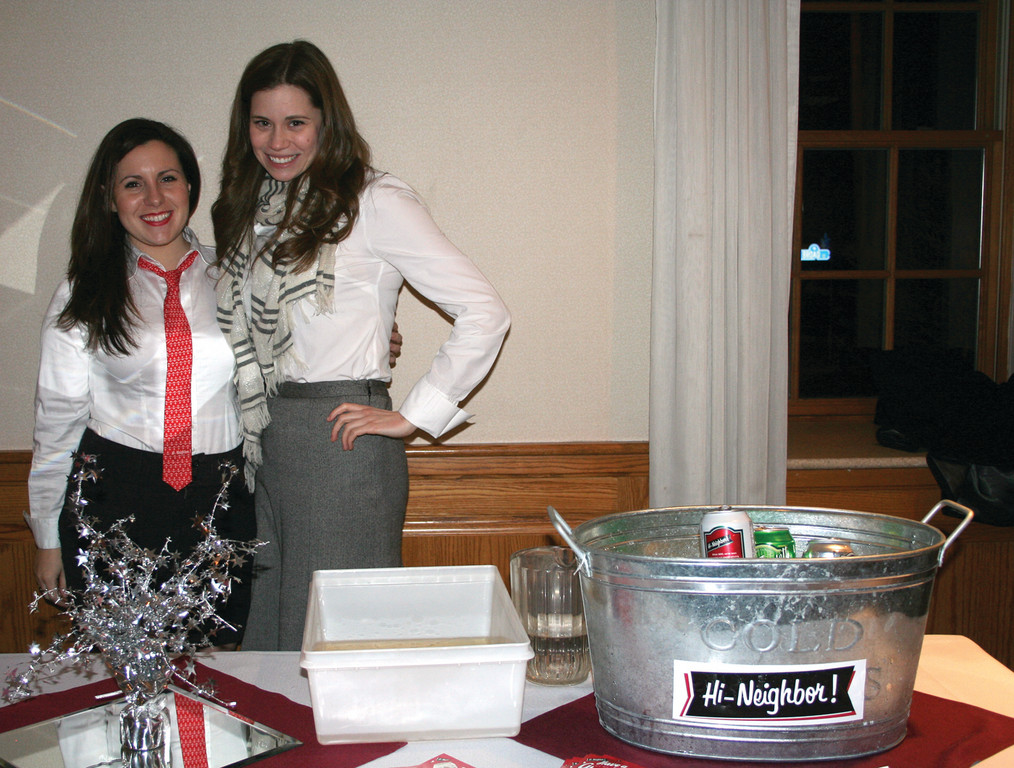 HI NEIGHBOR! Erica Keating and Michelle Lewis pass out samples of beer from the Narragansett Brewery, including the traditional 'Gansett and one of their Bocks.
