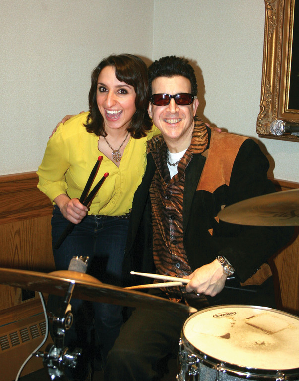 SUPER FAN: Danielle Zarrella from BORI Graphix poses with Sal Barone, drummer and lead singer for The Vegas Lords.