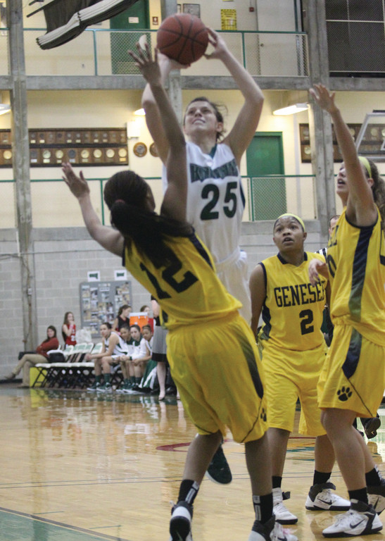 ATTACKING THE HOOP: CCRI's Jess Randall goes up for a shot in traffic during a game against Genesee earlier this year.