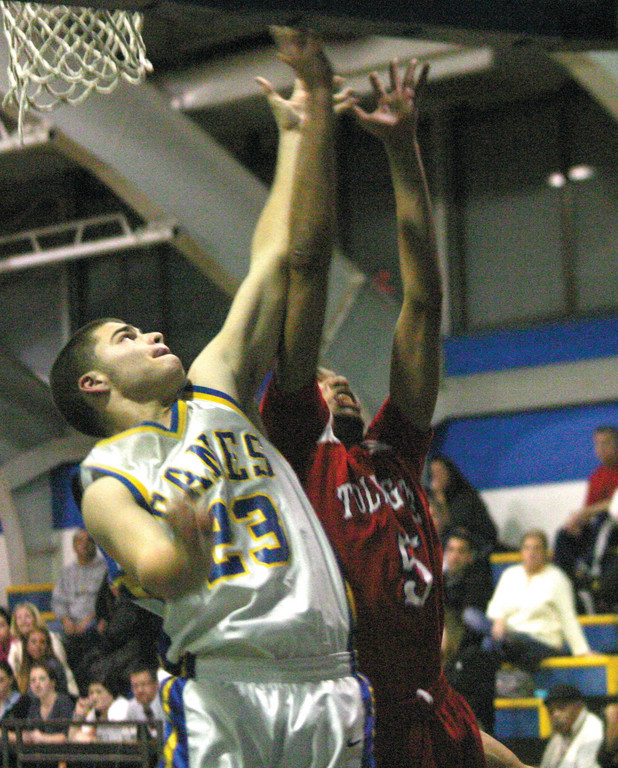 BATTLE ON THE BOARDS: Vets' Travis Babcock and Toll Gate's Mike Reyes jockey for a rebound.
