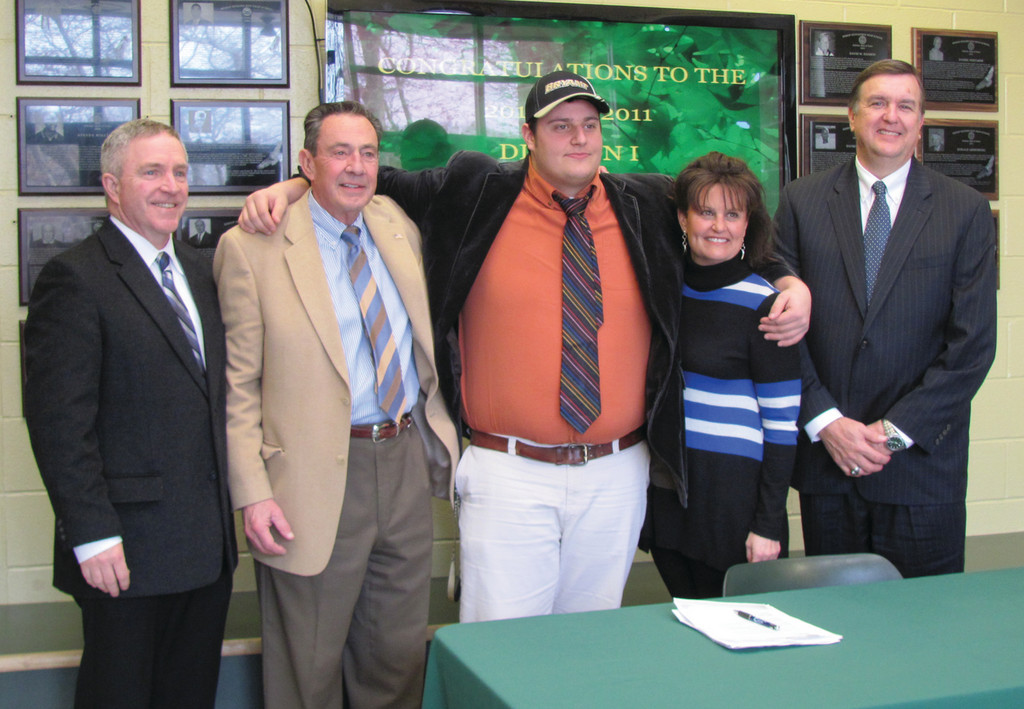 SIGNING CELEBRATION: Hendricken's Max Heintzelman signed a letter of intent Wednesday to play football at Bryant University. Pictured, left to right: Hendricken Principal Jay Brennan, Carl Heintzelman, Max Heintzelman, Lisa Heintzelman, Hendricken President John Jackson.