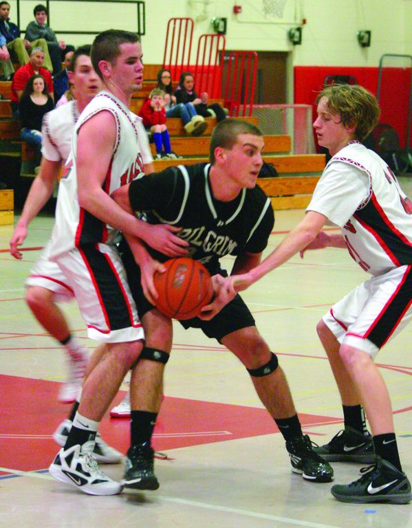 REACHING: Pilgrim's Ryan Morris tries to keep the ball away from Narragansett's Patrick Degnan (left) and Zach McKanna. The Pats lost 61-49.