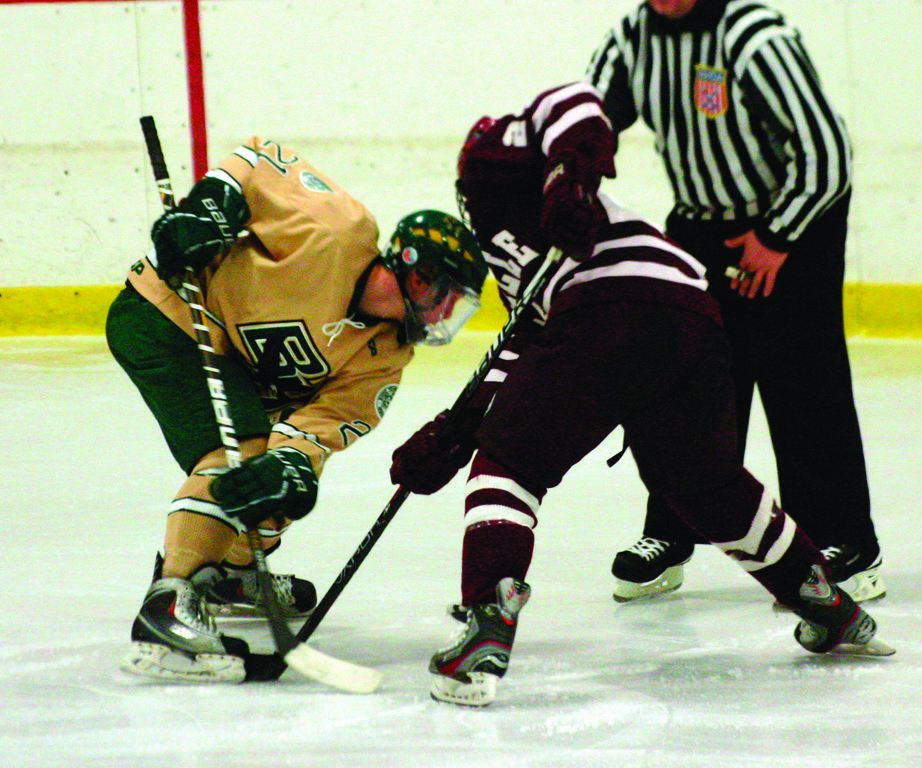 FACING OFF: Hendricken's Ed Markowski battles for the puck in Saturday's game against La Salle. After a loss to Mount last week, Hendricken returned to the ice with two wins.