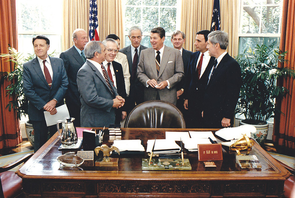 In the Oval Office, 1986, with President Reagan, Secretary of State George Shultz, Secretary of Defense Caspar Weinberger, and others.