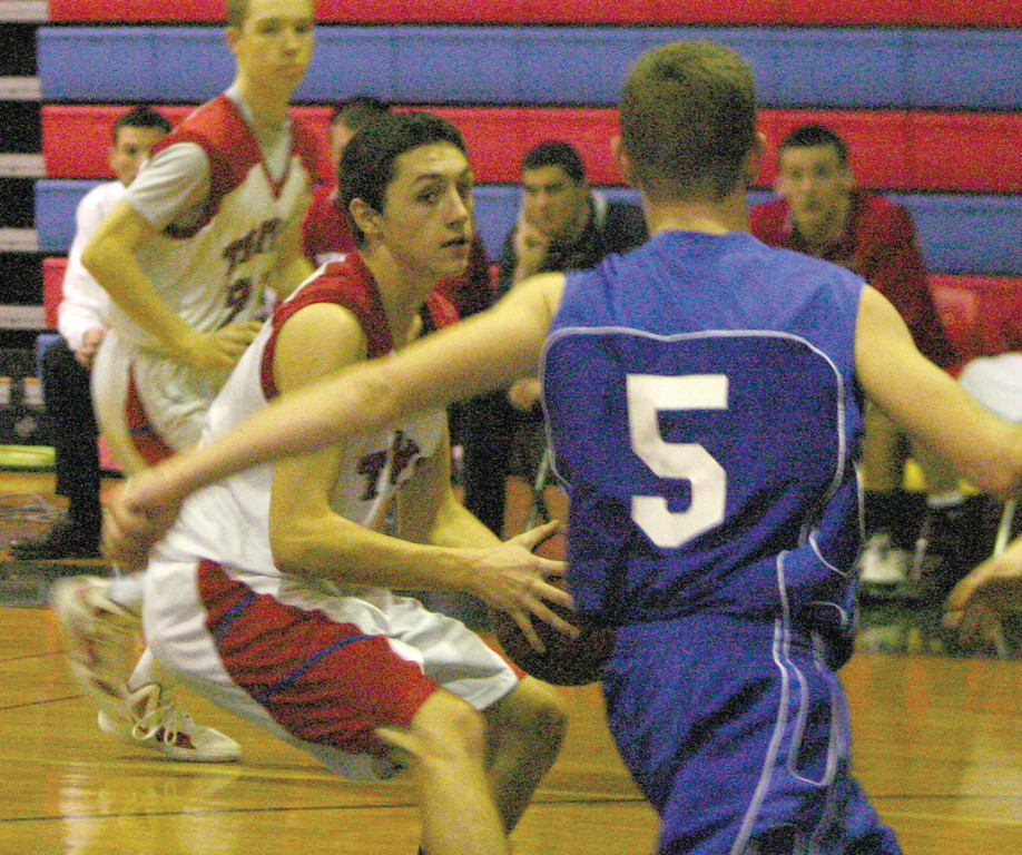 ON THE RUN: Toll Gate's Ben Mann pulls up on the fast break in Tuesday's game against Fatima.
