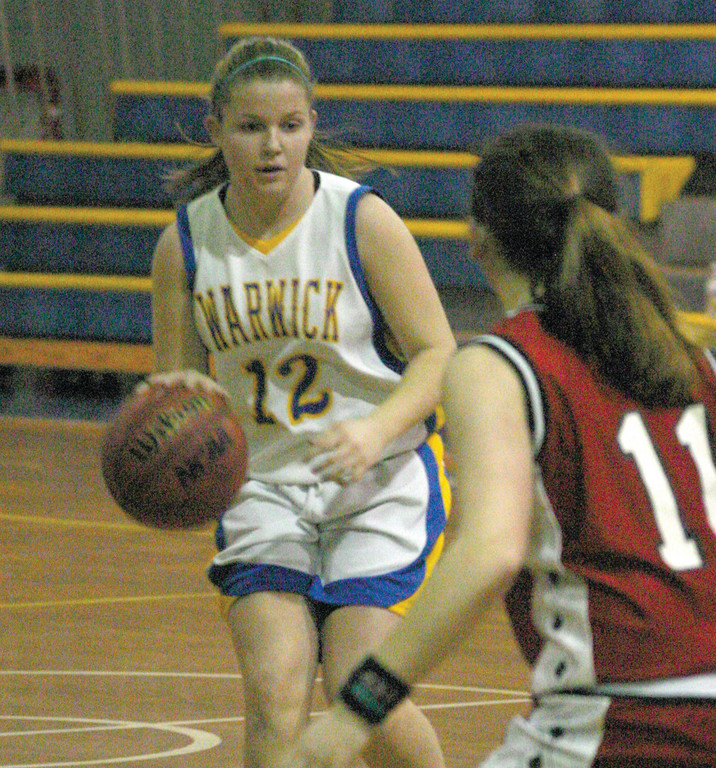 Casey Bennett dribbles the ball up the court.