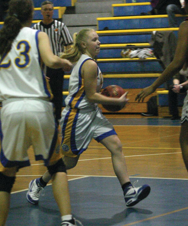 Liz Bailey drives through the paint.