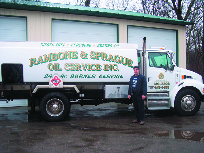Eddie Rambone, of R & S Oil Service, shows off one of his signature delivery trucks.