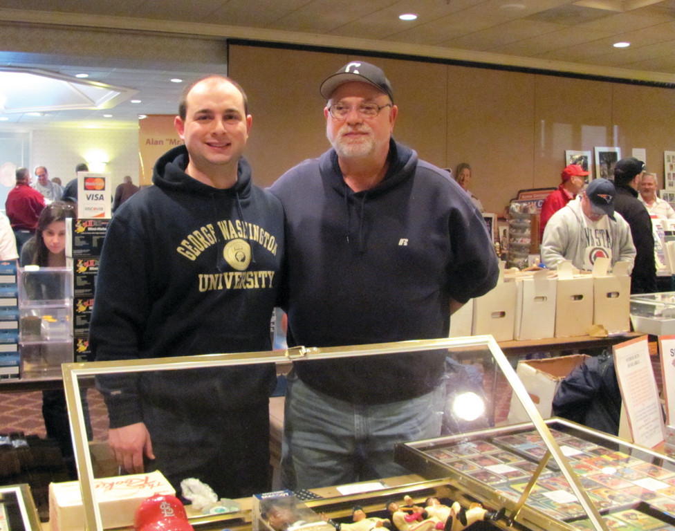 SUPER SPORTS HEROES: Mike Miller, who owns and operates Sports Heroes, a sports card and memorabilia store at 661 Oaklawn Avenue, is joined by his son at the show in West Warwick.