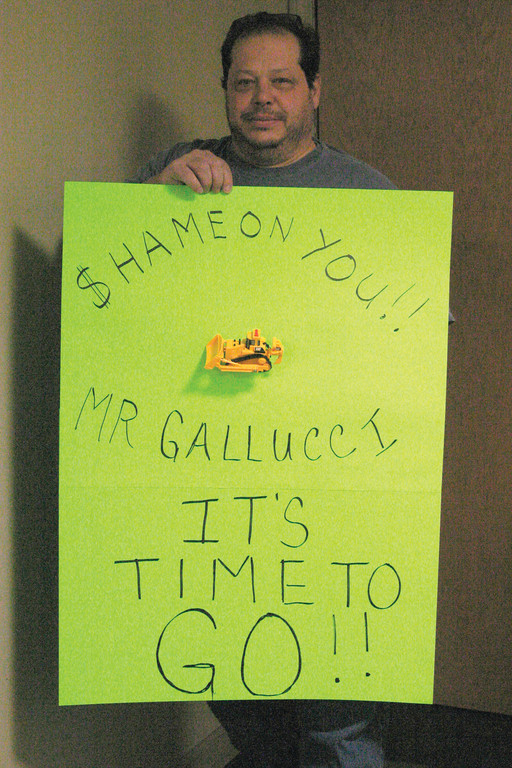 "UNLOADING HIS FEELINGS: Mike DiSalvia crafted a sign that he brought to Monday night's City Council meeting that urged Ward 8 Councilman Raymond Gallucci to resign, as Gallucci recently received and then returned $9,675 to contractor C.P. Watson, Inc. for operating his front-end loader for nearly 60 hours to help clean up damage caused by Tropical Storm Irene in August. ""He should have known better,"" DiSalvia said."