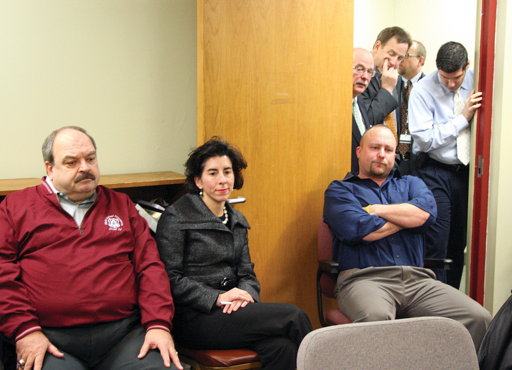 TIGHT QUARTERS: With Rhode Island Airport Corporation CEO Kevin Dillon peering in from the doorway, State Treasurer Gina Raimondo, flanked by Bill Holmes, business manager of Carpenters Local 94, at left, and Brook DeSaint listen to committee testimony yesterday.