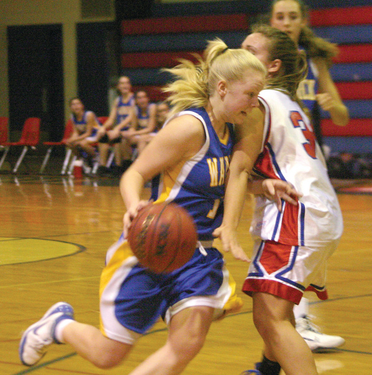 POWER DRIVE: Vets' Liz Bailey runs into Toll Gate's Ingrid Freeman on her way to the basket during Monday's game.