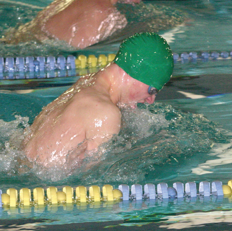 Jon O'Connell swims in the 100 breaststroke.