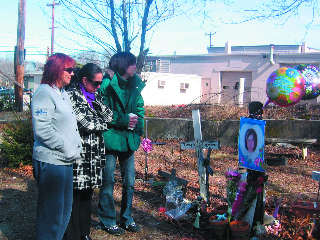 REFLECTING: Nine years have passed since the Station Nightclub fire claimed the lives of 100 people, including Dina DeMaio, who was a waitress at the club and perished on her 30th birthday. Her loved ones, Patricia Belanger, Barbara Mendez and Jessica Garvey are hopeful a proper memorial will be erected soon.
