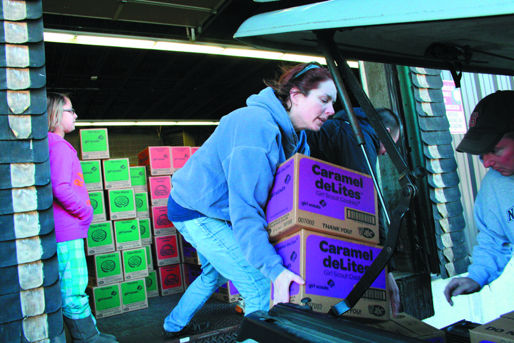 COOKIE BRIGADE: Lisa Harris helps load cartons of cookies to be delivered to members of Warwick Girl Scout Troop 110.