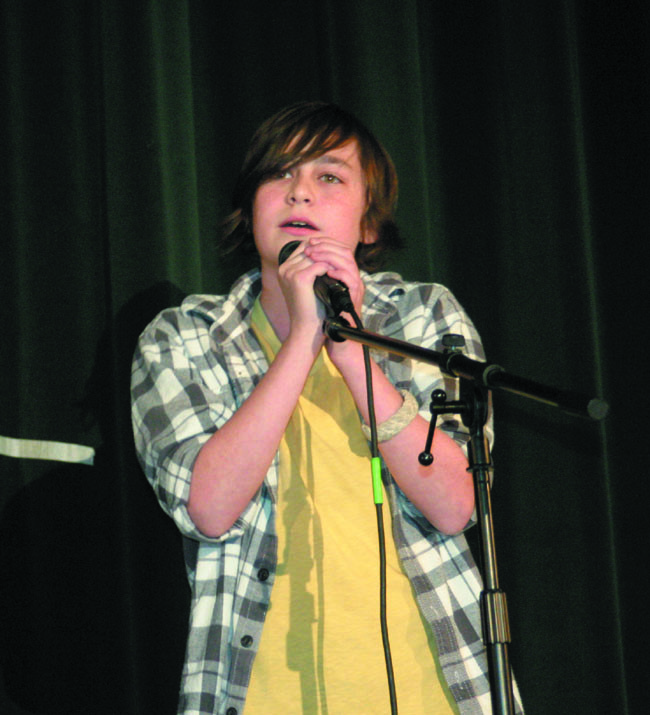 "SINGING SENSATION: Donnie-Ray Brearton, 14, who is in the eighth grade and auditioned for FOX's musical competition show, ""The X-Factor,"" won third place for his performance of Adele's hit song, ""Someone Like You."""
