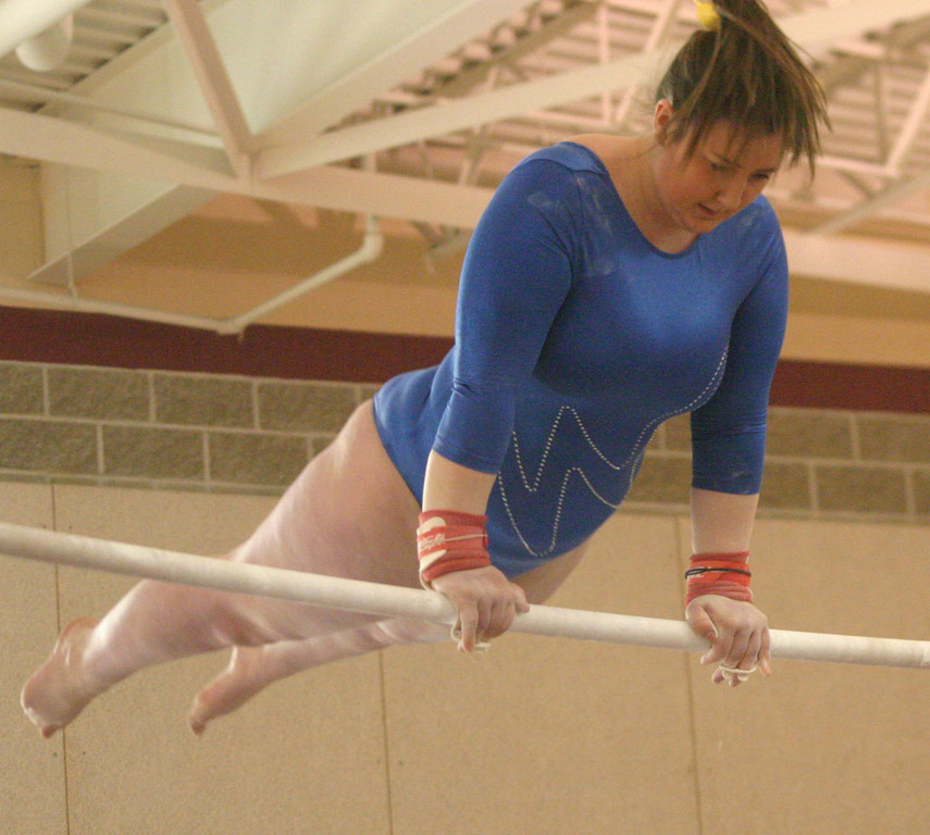 Kristen Hyle balances herself on the bars.