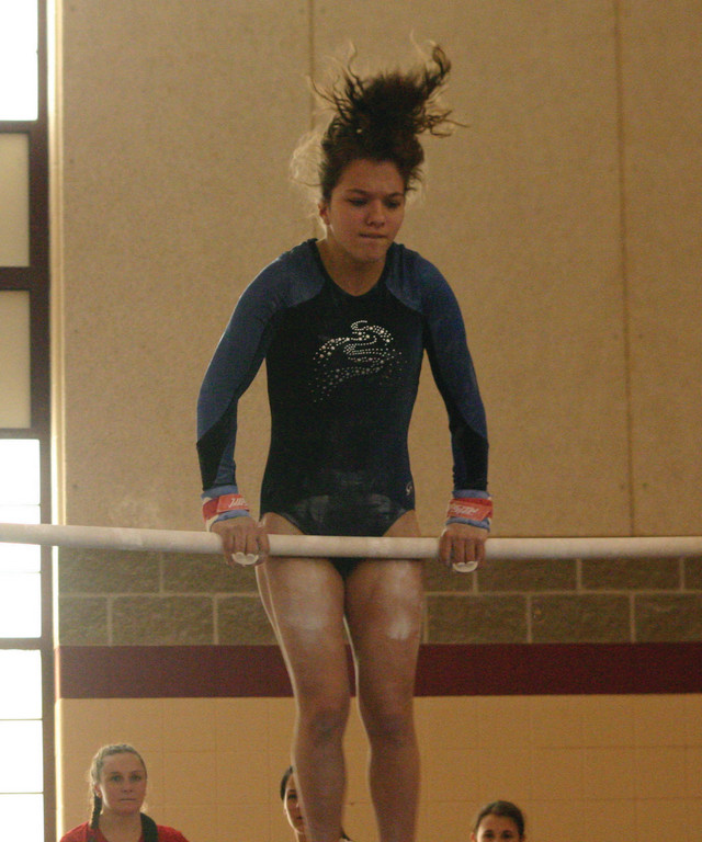 BAR EXAM: Toll Gate's Molly Fox competes in the bars during Sunday's state meet.