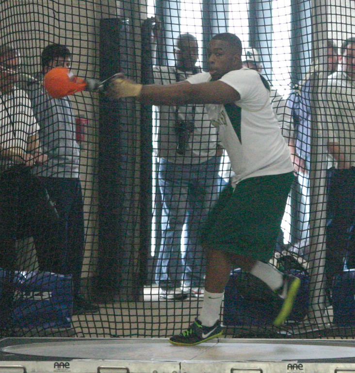 THROWING IT: Hendricken's Reuben Horace won first place in the weight throw.