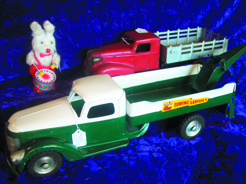 "Check out this 1947 Buddy ""L"" Tow Truck, this 1950 Wind-up Easter bunny and this 1930 Wyandotte, wood-wheel truck."