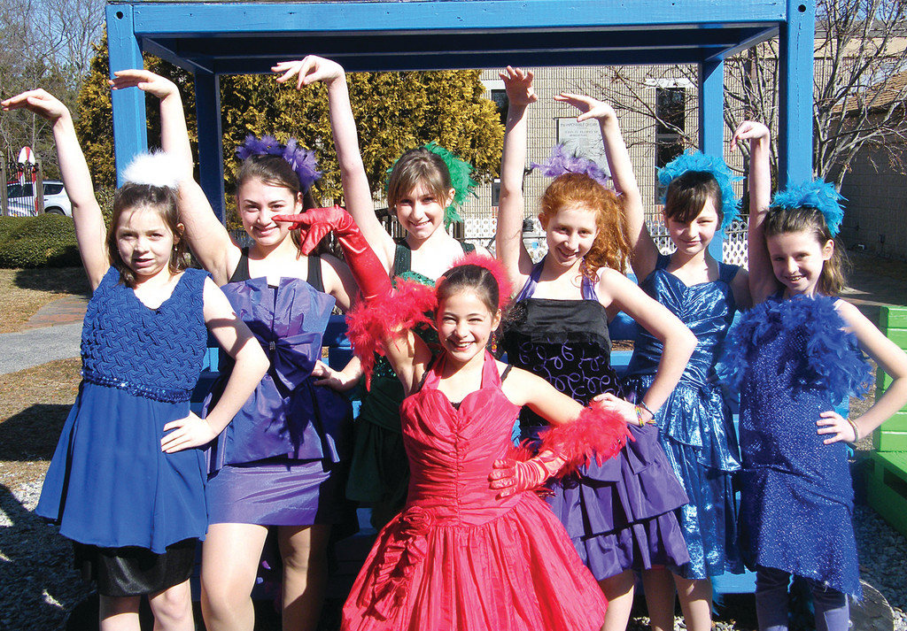 WHAT'S THE WORD, BIRD? The Bird Girls include, in the back row, Kathryn Moore, Eliana Stein, Brooke Fennell, Sophia Dilibero, Kayley Sullivan and Cara Weedon. In the front is Macie Johnson as Mayzie la Bird.