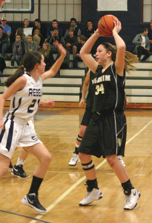 GOING UP: Megan St. Jacques makes a pass.