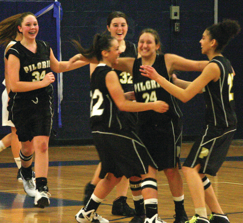 IT'S BEEN A WHILE: Pilgrim players celebrate Tuesday night after finishing off their first Division I win since moving to the league last season. Danielle LeBlanc hit three free throws with 0.7 seconds left to give the Pats the victory.