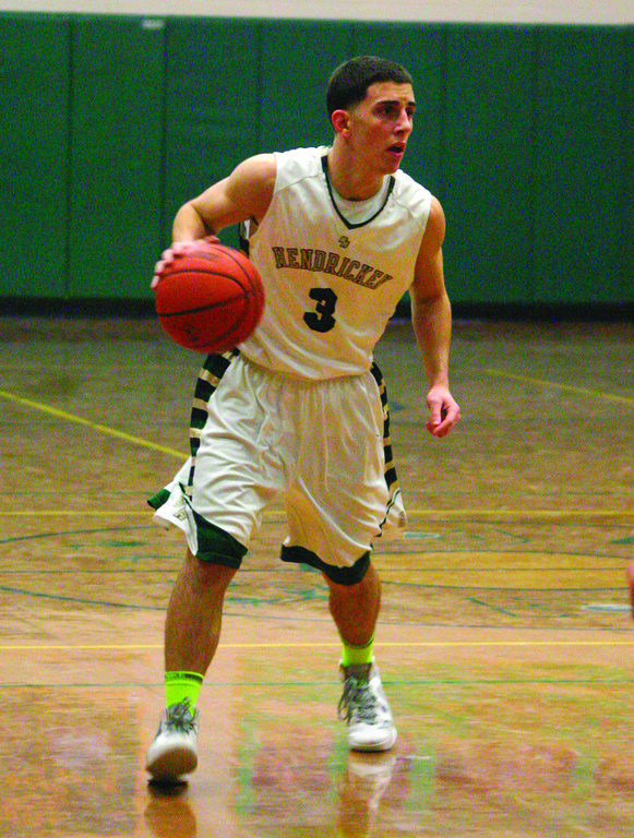 EYES UP: Hendricken's Corey Palumbo searches for a teammate in a game against St. Raphael.