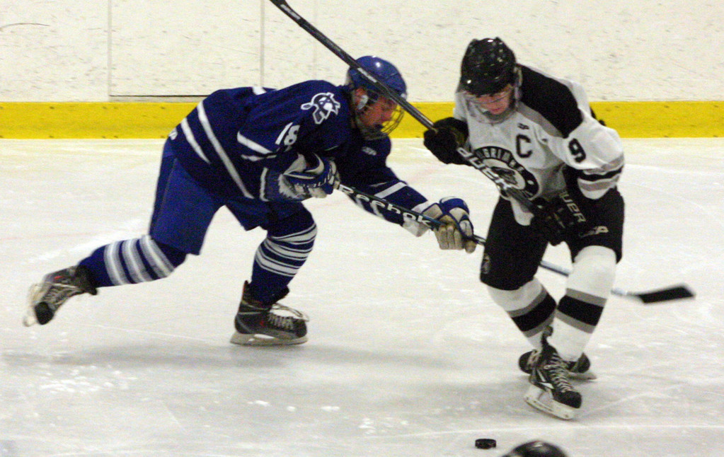 ON THE PUCK: Pilgrim's Cody Weaver, right, fights for possession of the puck with a Cumberland skater.