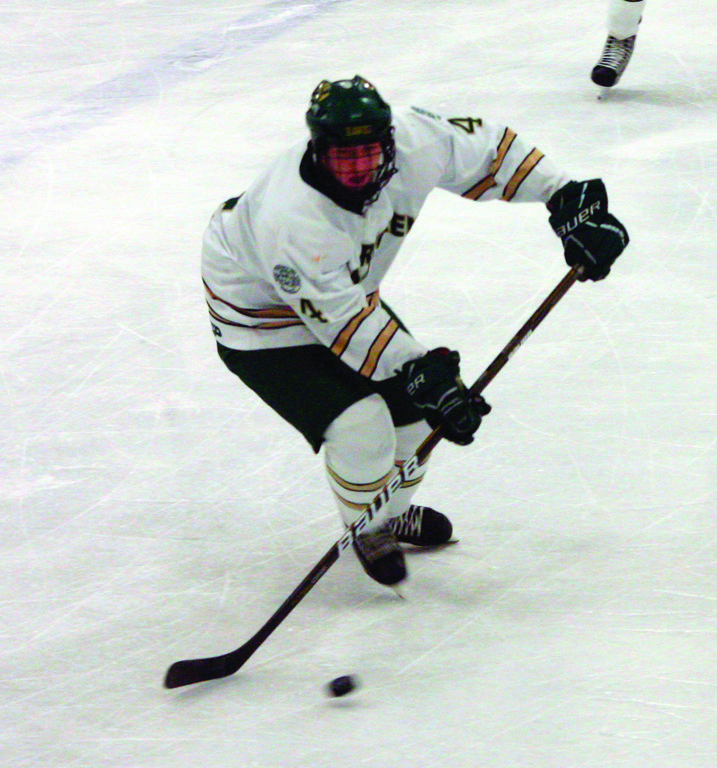 CLEARING IT: Nick Bodziony pushed the puck ahead in a game earlier this season. Bodziony will help anchor the defense as the Hawks open the postseason this weekend against Burrillville.