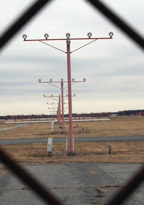 This end of Green Airport's main runway just off Main Avenue would be extended by about 1,500 feet, assuming approval of a memorandum of understanding between the airport and the City Council, dismasall of the council's lawsuit and federal funding.