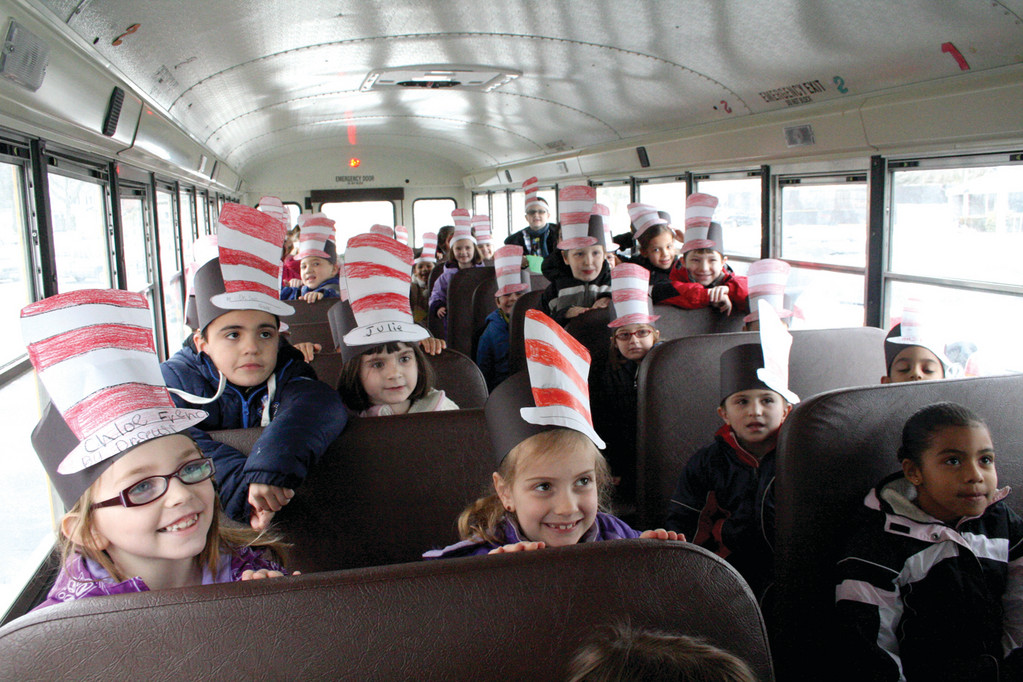 BREAKFAST BUSLOAD: Hoxsie School first graders arrive at the IHOP ready for a morning filled with such delights as green eggs and ham and truffula chip pancakes. The restaurant is offering the unusual menu through April 1.