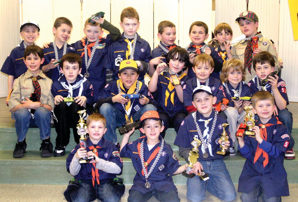 PINEWOOD PROUD: All participating Scouts earned medallions, while the top four boys earned trophies. In front, from left, are the first, second, third and fourth place winners, Brandon Rooney, Andrew Clyde, 6, Nick Trainer, 8 and Brenden O'Toole, 6.