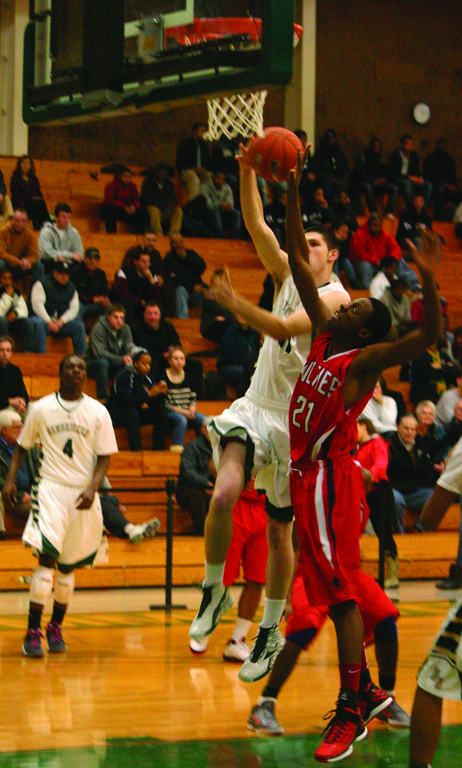 TO THE RACK: Hendricken's Nick Bordeau rises up for a layup over Edward Cooper.