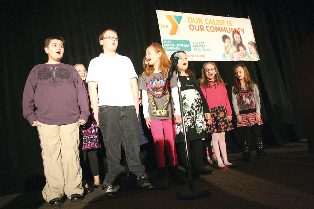 CERTAIN HIT: Members of the Kent YMCA Glee Club take to the stage for the kickoff of the YMCA of Greater Providence Annual Support Campaign yesterday at the Crowne Plaza.