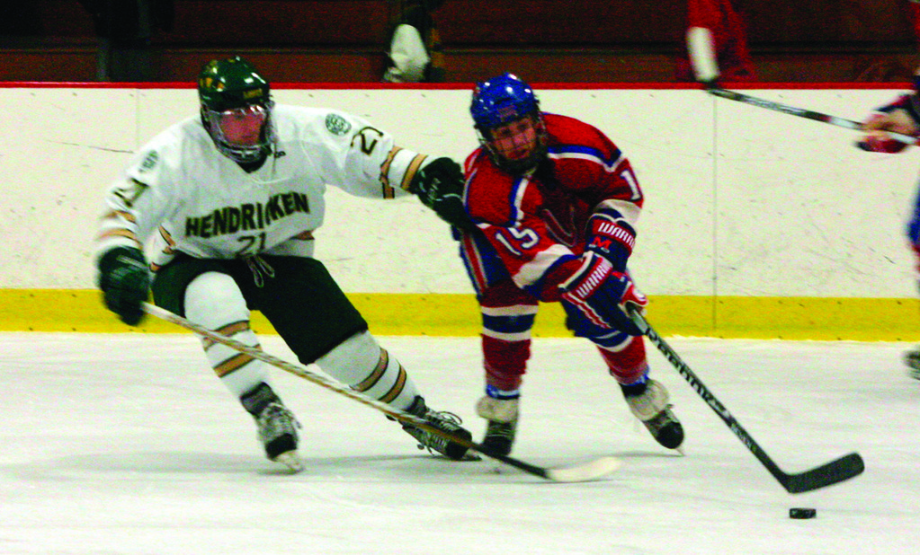 FAMILIAR FOES: Hendricken's Ed Markowski and Mount's Ryan Berard battle for the puck in a game earlier this season. The teams played four times this year and are in the championship together for the fifth time in six years.