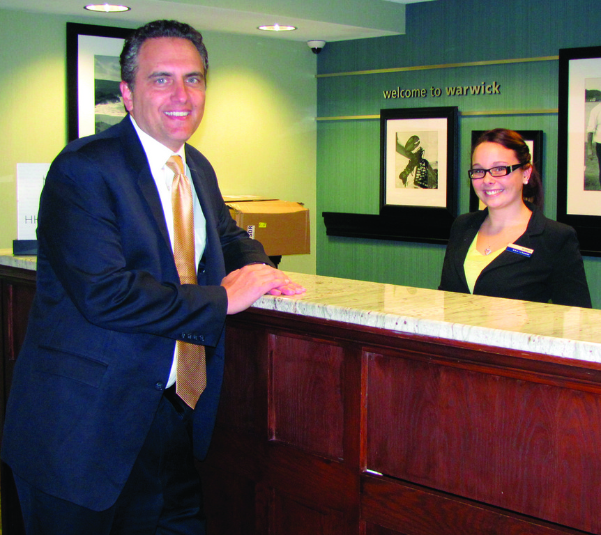 WEEKEND IN WARICK: Robert Krantz, a nationally-acclaimed and award-wining author and actor who lives in California, enjoys a lighter moment with Brittany Provost, a front desk associate at the Hampton Inn & Suites on Post Road in Warwick where he made his home last weekend.