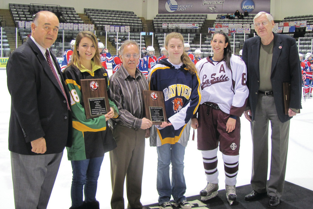 "HONORED: The Rhode Island Reds Heritage Society presented its second annual ""Unsung Hero Awards"" Sunday at PC's Schneider Arena. Among those presenters and recipients were, from left: Rick Scherza, North Smithfield's Hannah Decelles, Andre Mayer, Bay View's Marissa Golda, La Salle's Jenna Pari and President Buster Clegg."