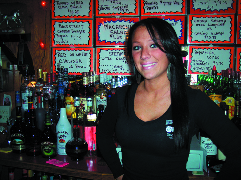 Bartender Michelle prepares your favorite drinks from Backstreet's full service bar.