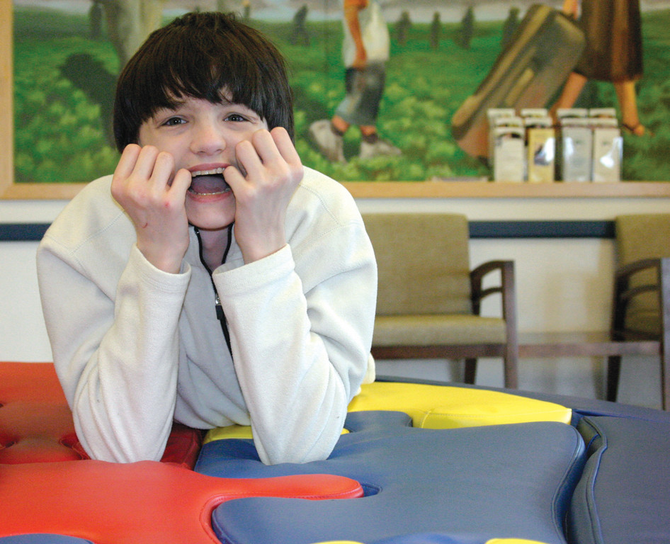 BIG SMILE: The Greenwood Credit Union recently made a $45,000 five-year pledge to the Trudeau Center, enabling them to enhance and expand the Pathways Strategic Center, a program to focus on children diagnosed with Autism Spectrum Disorders in Coventry. Caleb Barclay de Tolly, 16, is a student.