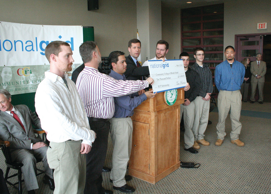 SCHOLARSHIP SUPPORT: National Grid announced Friday $10,000 in scholarships to the first class of CCRI's energy utility technology program. Here, the students gather with dignitaries at the announcement.
