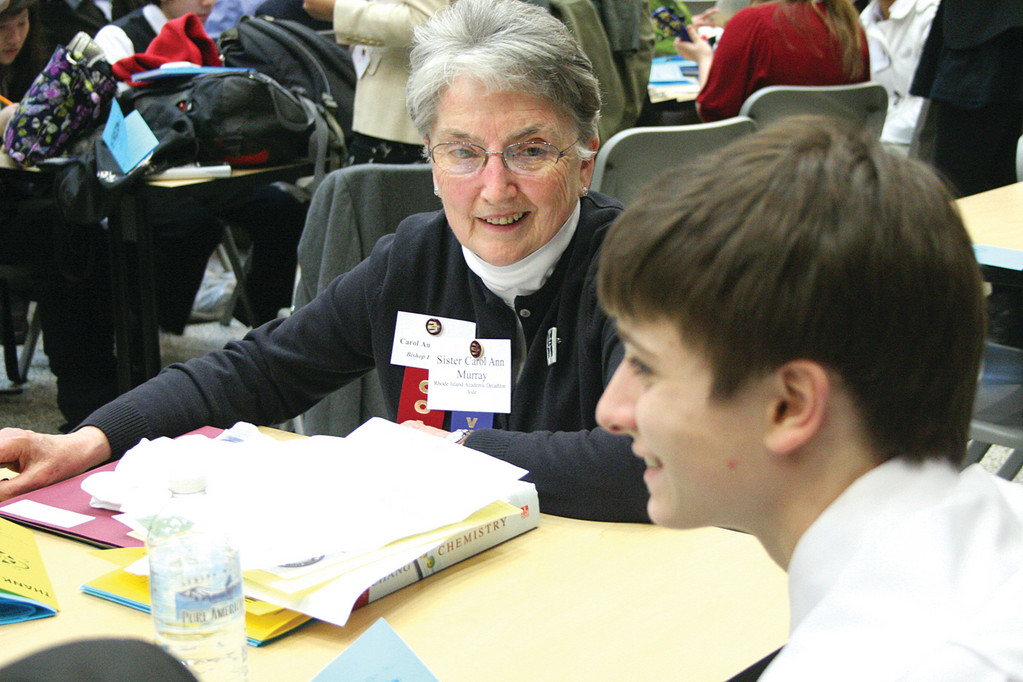 CHEMISTRY OF A WINNER: Hendricken's Sister Carol Anne Murray, a chemistry teacher, has been coaching the school's academic decathlon team for the past 22 years. She is seen here prior to the start of the competition Sunday at the Knight Campus of CCRI.