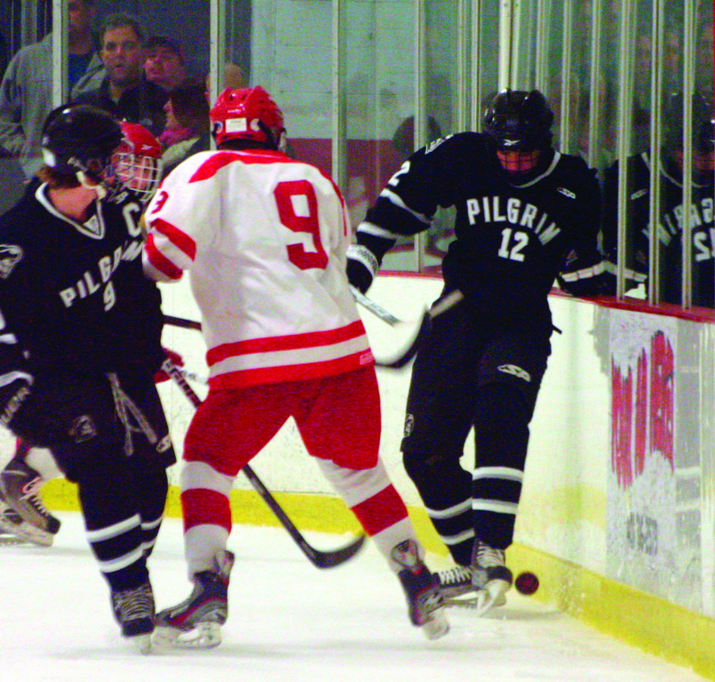 Sam Adamo tries to trap the puck with his skates.