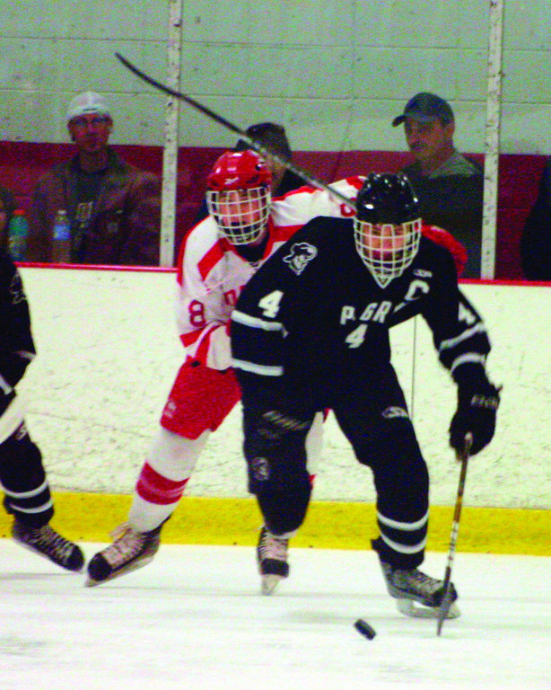 AWAY WE GO: Dylan LeGarie races for a puck during Friday's game one.